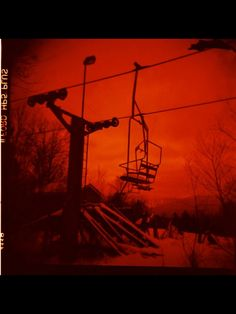 """""""Tips Up"""" is a photograph taken with a Holga camera. This photo was taken at an abandoned ski resort in the Catskill Mountains of New York. This can be found on Etsy at https://www.etsy.com/shop/CBrowerCreations"""