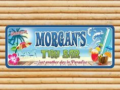 Tiki Bar Custom Personalized Sign with Surfboard and Tropical Drink, Tropical Decor, Beach Bar Decor. The warm tropical breezes of a seaside getaway will always be present in your home with this Custom Personalized Tiki Bar Sign. This sign depicts an ocean breeze, tropical flowers, surfboards, palm trees, waves and tiki drinks. With its universally appealing theme, this sign makes an amazing gift for family, friends and even yourself! Give your Tiki Bar the crowning touch it deserves with...
