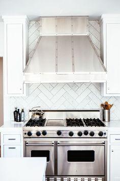 Designer Alexandra Kaehler reveals the striking before and after of an elegant kitchen makeover.