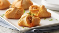 These delicious crescent bundles are filled with a creamy, cheesy chorizo filling perfect for serving as a quick and easy appetizer.
