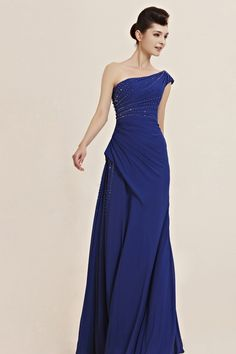 CARNEY IN ONE SHOULDER ROYAL BLUE EVENING DRESS  Simply classy bright royal blue evening dress featuring floor length asymmetric A Line silhouette with flare skirt, side ruched bodice embellished with white, black, and silver crystals all through neckline, strap and back.  £190.00