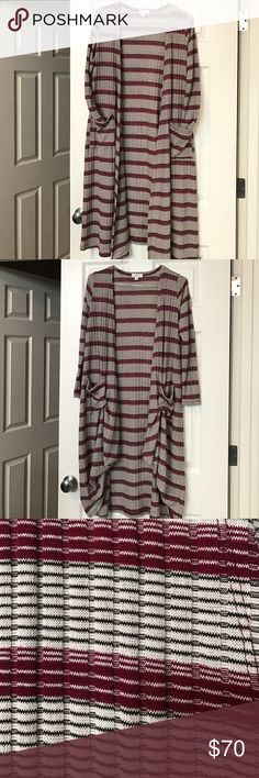 LuLaRoe Small Sarah Duster/Cardigan ❤ This is a Small Sarah with lots of Stretch, worn once. No snags or Holes, Brand New. This Amazing Sarah can be layered, used as a cardigan and can be pulled up into the pocket to use as a layering effect. (Seen in photo 2) just google Sarah tricks, so many ways this can be worn! Colors are Black, White and deep Red wine Color/Maroon. LuLaRoe Sweaters Cardigans