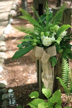 Fern Wedding in the Mountains: Fern and white hydrangea flower arrangement for wedding entrance