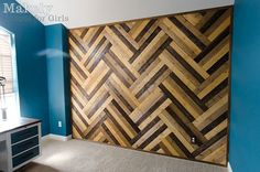 DIY Herringbone Wood Paneled Wall | Makely School for Girls == she used paneling from Home Depot, and stained the wood different colors. Cost her about 95 dollars for the wood. Very, very cool.