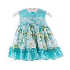 www.pepaonline.com    Estará preciosa! Vestido turquesa de flores y topitos de la Marca Marta y Paula en Vestidos para Bebé. Ya está aquí la moda infantil para el verano