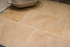 Our very popular Cirencester Gold limestone is finished with a heavy rustic edge which is perfect for older properties, barn conversions and large open living areas where a beautiful but durable floor is needed.  #hardwearing #limestone #flagstones