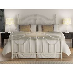 Give your bedroom a fresh update with the Roxie queen-size bed featuring a traditional design. This bed also highlights an antique white metal finish and includes a headboard, footboard, side rails and cross bars.