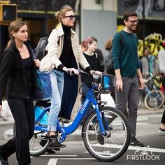 Karlie Kloss citybike bicycle in the streets of Manhattan on December 12, 2015 in New York City.