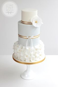 Pale blue and gold wedding cake with wafer paper flowers For more cake inspiration check out my Beautiful Wedding and Engagement Cakes ideas And also for Wedding, Birthday and Occasions Beautiful Wedding Cakes, Gorgeous Cakes, Pretty Cakes, Cute Cakes, Fondant Cakes, Cupcake Cakes, Wafer Paper Flowers, Cake Flowers, Fondant Flowers