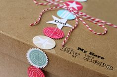 """Love the """"ribbon"""" idea on this present. Punches out of scrabook paper sewn together."""