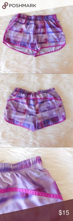 EUC Women's New Balance Running Shorts Purple & pink kind of tye-dye design! Size small. Excellent condition! No signs of wear! Lined w/ a drawstring!  I have lots of workout clothes, so bundle & save!  New Balance Shorts