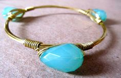 Teal and gold bangle bracelet.. Stunning! This bead shines off the gold piece of jewelry! Handmade for you at www.rocmeout.com
