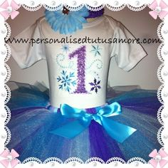 Oh my goodness!! How popular is the frozen Winter wonderland partytheme this year in 2014?   This is a sweet request for a snowflake inspired 1st birthday tutu set in the colours of Aqua blue and purple. Our personalised top has a lilac purple shimmer glimmer number 1 (but can be swapped to the number of your choice (ie: 2 for 2nd birthday, 3 for 3rd birthday, 4 for fourth birthday etc etc) and has 2 snowflakes, one in a royal purple and the other in aqua blue. It is then teamed with our