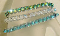 This pattern is a basic right angle weave design. This pattern is often called the tennis bracelet. With 5mm BI cones it really has extra BLING. It uses 5mm Bi-Cone crystals with Delica 10/0 seed beads and either 11/0 or a 2mm ball . This Right Angle Weave (RAW) Bracelet is a perfect way to learn the basic 2 needle RAW style of weaving. The pattern is 5 pages in color and fully illustrated with diagrams. You will need a #10 or 11 needle to complete this piece and either 8 pound fire...