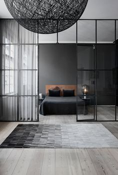 Dark and minimal bedroom with Random pendant from Moooi