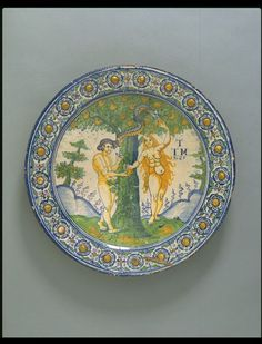 The Temptation of Adam and Eve Object: Dish Place of origin: London, England  made  Date: 1635  made  Artist/Maker: Pickleherring Pottery  probably, maker  Materials and Techniques: Tin-glazed earthenware, painted in oxide colours Museum number: C.26-1931
