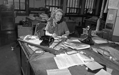 Aggie Underwood, city editor of the Los Angeles Herald-Examiner, in 1949.  Los Angeles Public Library.  Note the baseball bat she kept on her desk to control unruly journalists on her staff.