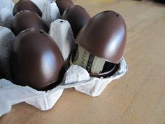 I wish I had seen this last month! Spray painted plastic eggs to look like chocolate. : )