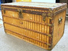 LOUIS VUITTON WOOD-STRAPPED CLOTH-BOUND STEAMER TRUNK, C. 1900, OF TYPICAL FORM, WITH VERTICAL STRIPED PATTERN, BRASS MOUNTINGS, INTERI - Skinner Inc