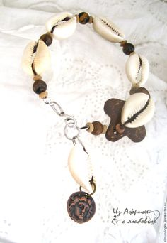 $12,26   #anklet, #African_jewelry, #cowry , #coconut shell   Buy and order Anklet Tiger eye Mystic Coconut on Livemaster online shop. Shipped over Russia and the CIS. Production time: <br />. Materials: beads, hematite, waxed cord, hematite…. Dimensions: Diameter of beads:8mm <br /> Length:…