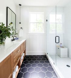 Can we talk about how gorgeous this bathroom is? We love the combination of white walls, black hex tiles and wood cabinetry! For more hexagon tile inspiration head to the website. Design by Photo by Bathroom Floor Tiles, Bathroom Renos, Black Bathroom Floor, Wood Tile Bathrooms, Rain Shower Bathroom, Tile Floor, Black And White Tiles Bathroom, Pavillion, Apartment Decoration