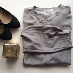 Sleek Grey Top with Dark Silver Rhinestones This long sleeved, button up, sleek, grey top with dark silver rhinestones is absolutely gorgeous! It is a size large and has a button on each sleeve. So cute! Check it out! Liz Claiborne Tops Button Down Shirts