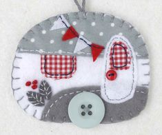 Grey and white felt caravan ornament
