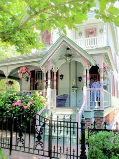 Pink Shabby Chic Victorian House Cottage with Pink and White Porch and Black Iron Fence