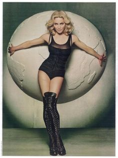 Madonna by Steven Meisel...would be a good pinup tattoo inspiration including the world in the back ground.