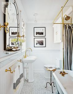 Everything about this bathroom is swoonable- from the simple, classic black and white palette to the bright brass fixtures.