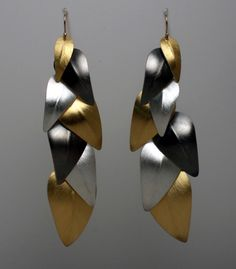 "Lynn Christiansen: Falling Leaves Earrings, In sterling silver, 22k gold bimetal, and 14k gold earwires. 3.5"" long."