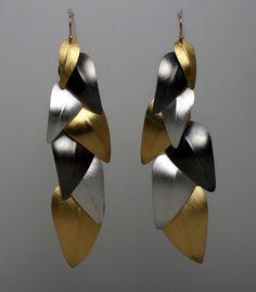"Lynn Christiansen: Falling Leaves Earrings, In sterling silver, 22k gold bimetal, and 14k gold earwires. 3.5"" long."
