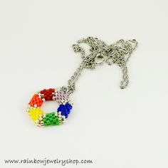 Woven with tiny glass beads, this pendant hangs on a 20 inch chain, which can be adjusted as needed.