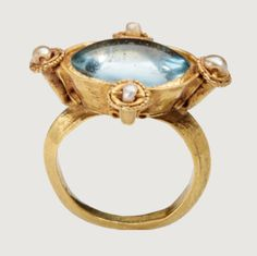 Byzantine blue glass, pearl, and gold ring, dating to the early 6th century CE.