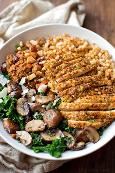 A quick pesto-like sauce brings this flavorful and filling parmesan chicken with sun-dried tomato cous cous and garlic veggie bowl together. I Love Food, Good Food, Yummy Food, Tasty, Cooking Recipes, Healthy Recipes, Cleaning Recipes, Cooking Tips, Spinach Recipes