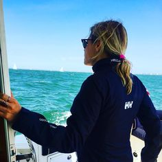 Looking at the horizon and enjoying a day of sailing in a blue HH fleece.  Beautiful.  Photo from @ c.olivia716 Instagram