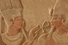 A bas relief of the god Amun-Ra making the gift of life (ankh) to the pharaoh Thutmoses IV. Sculpted in red quartzite, with traces of original paint remaining.  CREDIT: mountainpix  Karnak: Temple Complex of Ancient Egypt | LiveScience - Ankh