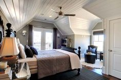 Cottage Master Suite with Open Bathroom, Set within the eaves of a front-gable Victorian cottage, this master suite has an open bedroom/bathroom concept, complete with a Japanese soaking tub., View from bath, with sitting room and French doors out to sleeping porch., Bedrooms Design