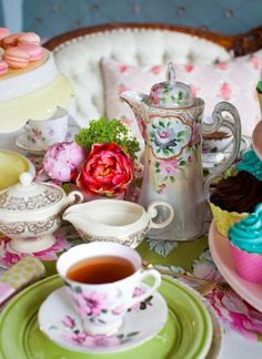 .Tall tea pot and flowers. (Pretty but the spout on the pot makes this a chocolate pot)