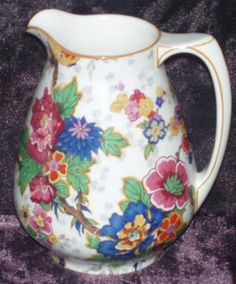 """Crown Ducal """"Festival"""" Chintz 5"""" Pitcher. Chintz, Oriental Lanterns, Mustard Trim.   Transfer pattern with hand painted mustard trim. Manufactured circa 1926, by A.G. Richardarson under the Crown Ducal Brand."""