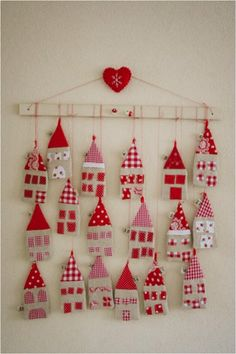 Little houses advent calendar. This advent calendar is a fun, popular way for kids and adults to count down the days until Christmas. Kids would love the surprises hidden behind each day. Christmas Projects, Felt Crafts, Holiday Crafts, Fabric Crafts, Christmas Makes, Noel Christmas, Christmas Ornaments, Christmas Calendar, House Ornaments