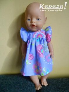 65a4ae8f2f8556 Nieuw paars jurkje met vlindermouwen voor babyborn