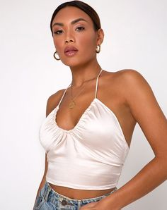Our Haltri crop top is sure to give your look a chic finish! Featuring a cropped halter neck fit with a scoop ruched neckline in a satin ivory materia. - Haltri Crop Top in Satin Ivory by Motel Diy Halter Top, Diy Crop Top, Crop Tops, Halter Neck, Halter Tops, Diy Fashion Tops, Fashion Outfits, 2000s Fashion, Fashion 101
