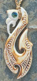 Manaia Bone Carving Necklace with Paua shell inlays and hot airbrushed colouring       www.boneart.co.nz