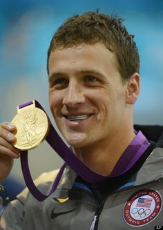 Ryan Lochte  United States' Ryan Lochte poses with his gold medal for the men's 400-meter individual medley swimming final at the Aquatics Centre in the Olympic Park during the 2012 Summer Olympics in London, Saturday, July 28, 2012. (AP Photo/Mark J. Terrill)