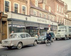 Time gone by: Old fashioned cars and a van for Smedley's Frozen Foods are parked along Bridge Street in the centre of St Ives Uk History, London History, British History, Local History, 1960s Britain, Old Fashioned Cars, Cities, Car Boot Sale, Old Street