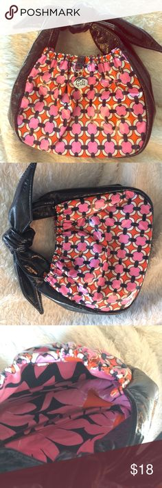 """Vera Bradley """"Frill"""" Mini Purse in """"Loves Me"""" This purse has been gently preloved, and still is in great condition!  It's an adorable tiny hobo purse from the Vera Bradley Frill line in the discontinued """"Loves Me"""" pattern.  The proceeds of this pattern went to breast cancer research.  This purse would be great for a little girl!  The dimensions measure about 5"""" x 7"""" x 3.5"""" with a 6"""" bow handle.  A very cute little purse! Vera Bradley Bags Mini Bags"""
