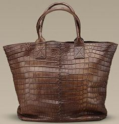 Handsome? Yes. A little over the top? For sure. Top-notch quality? Definitely. But is this Bottega Veneta Madagascar Tote really worth it? Even the die-hard Bottega fanatics may think twice about this dark brown crocodile bag. It's both chic and utilitarian, with an exquisitely crafted design. But it's no different from the hoards of croc totes available today. It was selected by Bottega's creative director as one of the season's must-have bags, it lacks those special little details. $18,400