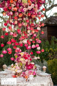 It's raining roses! This Rose chandelier is so unbelievably gorgeous! #pink Location Thomas Fogarty Winery