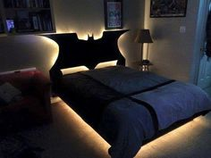 I'm totally digging the illumination behind this custom Batman bed. I don't quite have a Batman bed, but I do have the lights so I can see where I'm going at night! Cama Do Batman, My New Room, My Room, Batman Bedroom, Gamer Bedroom, Devon, Kids Bedroom, Bedroom Ideas, Room Decor